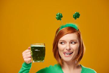 Playful leprechaun with green beer