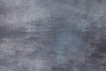 Grunge canvas coated with aqua blue and grey acrylic paint with texture strokes. Abstract textural background.