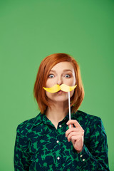 Portrait of playful woman with mustache in studio shot