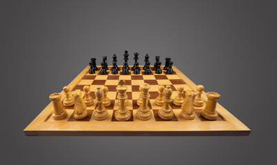 White and black chess pieces  placed on a chessboard