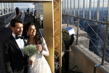Nachiket Patel and Chitra Pathak pose together following their Valentine's Day wedding ceremony at the top of the Empire State Building in New York