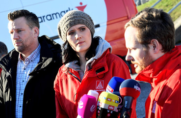 Sophia Kielhorn, head of works council Airbus Hamburg, Jan-Markus Hinz, head of joint works council Airbus Operations, and Emanuel Glass, chairman of German union IG Metall Hamburg, address media in front of the Airbus plant in Hamburg