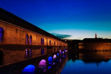 Illuminated Vauban Dam during sunset in Strasbourg