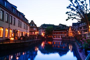 Ill river embankment during sunset, Strasbourg, EU
