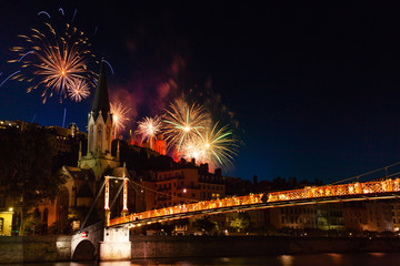 Fireworks lit up night sky over Saone River, Lyon