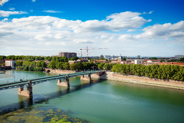 Toulouse cityscape and the Garonne river in summer
