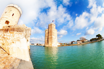 Downtown harbor old entrance towers of La Rochelle