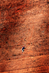 Man Rock Climbing Rockclimbing on Red Cliffs Sandstone with Ropes
