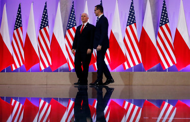 U.S. Vice President Mike Pence walks with Polish Prime Minister Mateusz Morawiecki at the Prime Minister Chancellery in Warsaw