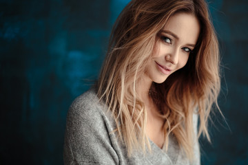 Portrait of sweet young blonde woman in artistic mood, fashion and beauty, casual style