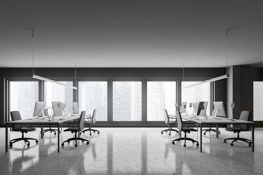 Gray open space office with windows