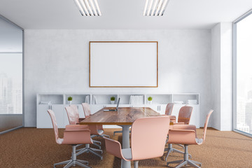 White meeting room with poster