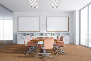 White meeting room with two posters