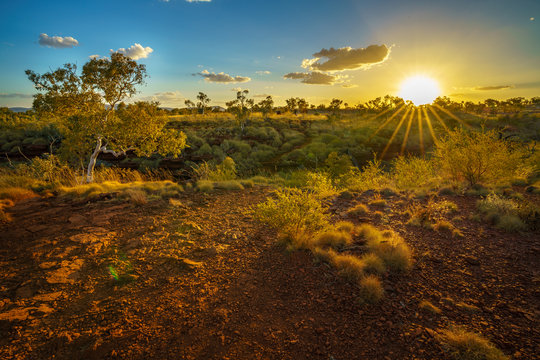 sun at sunset over joffre gorge in karijini national park, western australia 2