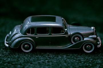Dark grey vintage car . Retro car's close up.Retro car on a dark background. Car close-up.