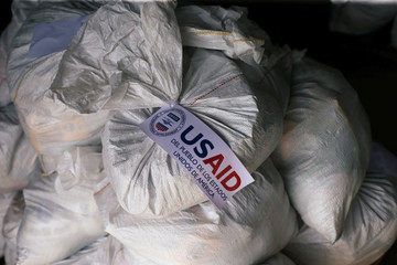 Sacks containing humanitarian aid are pictured at a warehouse near the Tienditas cross-border bridge between Colombia and Venezuela in Cucuta
