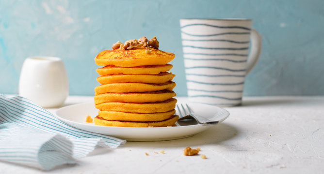 Pumpkin or Carrot Pancakes with Nuts, Stack of Homemade Pancakes