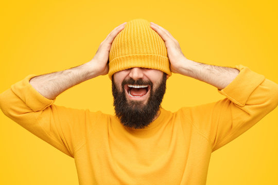 Stressed man in hat screaming