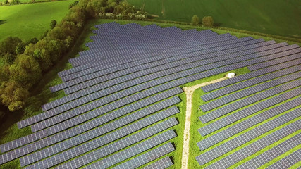 aerial view of Solar panels farm and agriculture fields