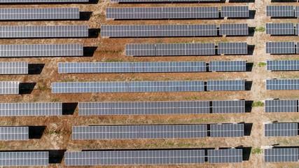 Solar panels field in desert. Alternative energy, ecology power conservation concept