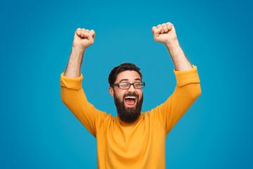 Fototapeta Funny man celebrating victory obraz