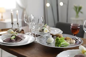 Fototapeta Festive Passover table setting at home. Pesach celebration