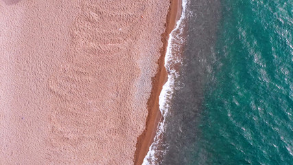 top aerial view of beautiful sandy beach and transparent turquoise sea