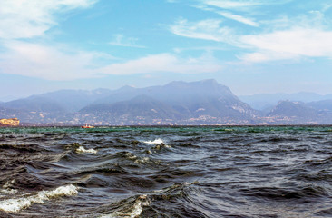 Beautiful photo of the sea in Italy. in the background are mountains. foreground sea and waves. sunny summer weather in Europe. beautiful wallpaper and travel screensaver. Motivation to travel to Ital