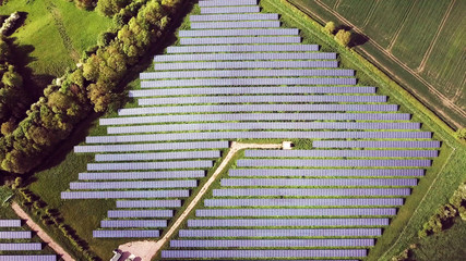 top aerial view of solar energy panels in solar energy farm, Photovoltaic power station