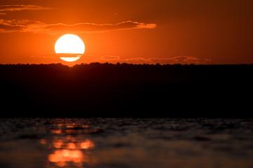 Fond de hotte en verre imprimé Rouge red sunset over the sea
