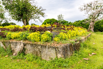 An ancient ziggurat Langi - Royal burial tomb - near Lapaha, in Mu'a, east of Tongatapu island, Tonga, Polynesia, Oceania. Stone vault, platform of earth, stepped pyramid supported by megaliths