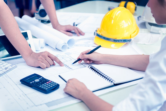Business Meeting Time with Architecture Interior Designer and Engineering. Meeting and Discussion about Construction Progress in work and Figures denoting of Accounting and Financial
