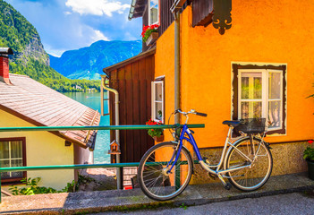 Wall Mural - Austrian Alpine house with bicycle in Hallstatt village, Austrian Alps,  Salzkammergut, Austria, Europe