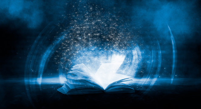 The book is open, magical glow, rays of light.