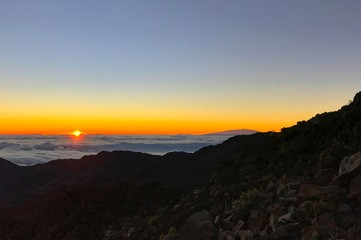 Sunrise at the top of Haleakala in Maui, Hawaii on a crisp sunny morning,