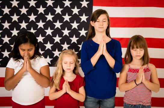 Group of Girls Praying by American Flag - Prayer, Religion, Hope