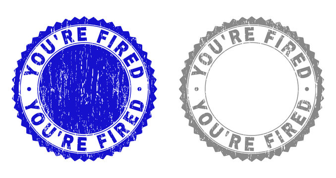 Grunge YOU'RE FIRED stamp seals isolated on a white background. Rosette seals with grunge texture in blue and gray colors. Vector rubber stamp imprint of YOU'RE FIRED text inside round rosette.
