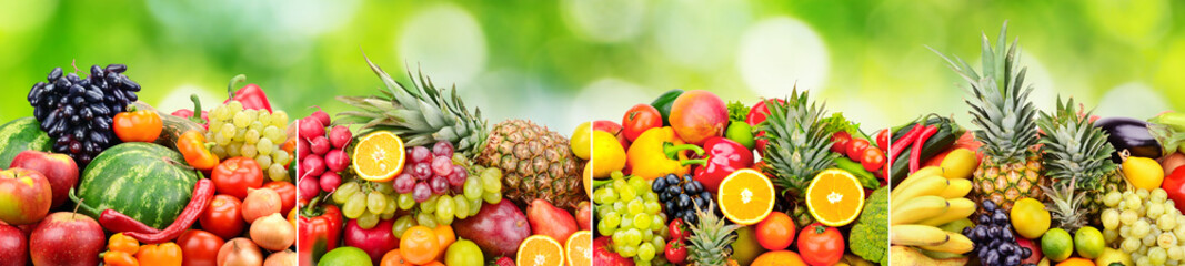 Panoramic skinali from bright fresh vegetables, fruits, berries on green blurred background.