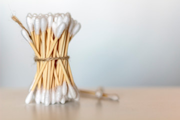 Bamboo cotton swabs on wooden table