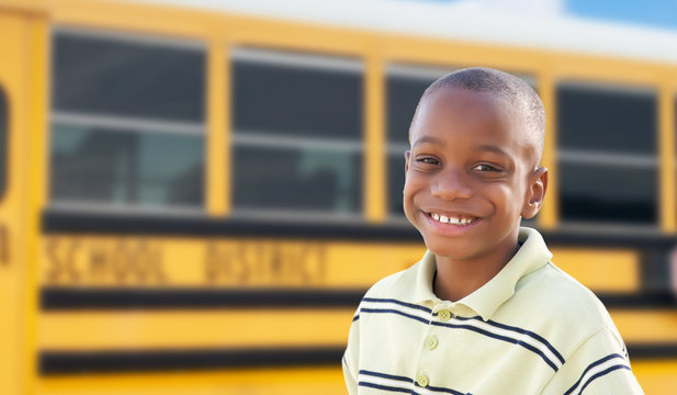 Young African American Boy Near School Bus