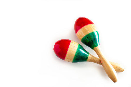 Two colorful maracas on white background. Cinco de mayo background.