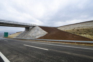New motorway under construction with dramatic clouds