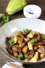 chayote with beef and sesame in asian style. The dish is popular in Asia, especially in Vietnam. recipe with chayote.