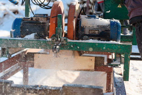 Sawing boards on the sawmill  Cook lumber in winter  Work on the