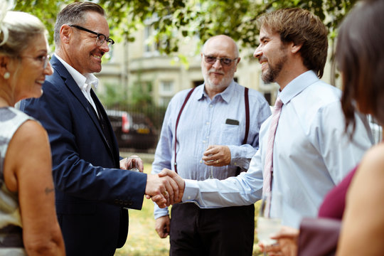 Men shaking hands at a party