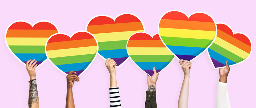 Hands holding a lgbt rainbow heart graphic