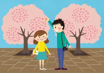 お花見で桜を楽しむカップル