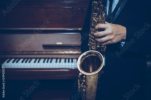 close up of Young Saxophone Player hands holding alto sax