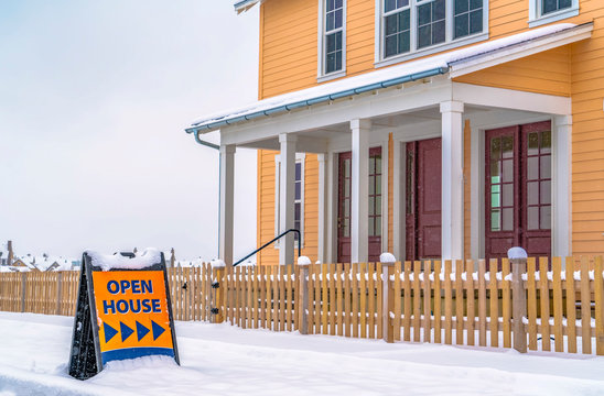 Property for sale with an Open House sign in Utah
