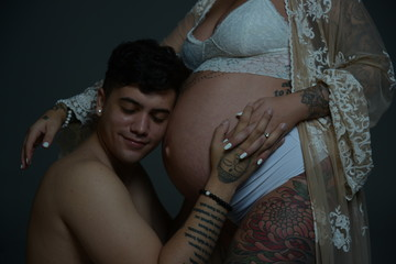 Couples in white pregnant wife